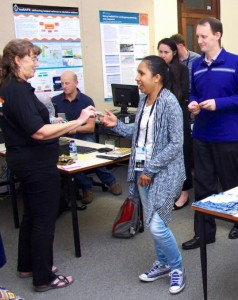 Handing out fridge magnets to participants. — at The University of Western Australia.